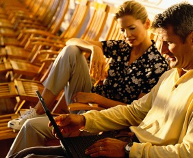 couple-on-a-laptop-on-deck-770